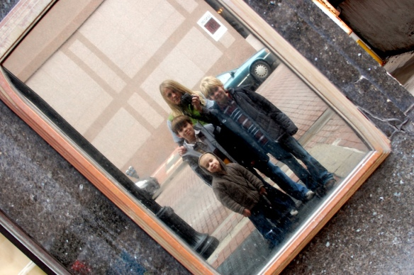 The Jacksons, reflected in downtown Indianapolis, during a recent adventure.