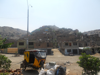 On the way to an artisan's home in San Juan de Lurigancho, a poor district in Lima, where residents have built homes into the side of a mountain Photo credit: Sam Carpenter