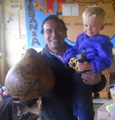 Having a young child along helped us establish warm interactions with others. Here, our son is with Emilio Hurtado, a carved gourd artisan in Huancayo, Peru. Photo credit: Sam Carpenter
